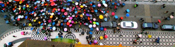 czech_republic.prague.spring2014.culture_customs_traditions.colorful_umbrellas_under_the_astronomical_clock.erin_mccarville