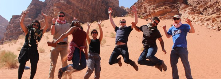 im-with-isa-jordan-wadi_rum-spring2016-with_isa-jumping_for_joy-andrew_faulhaber