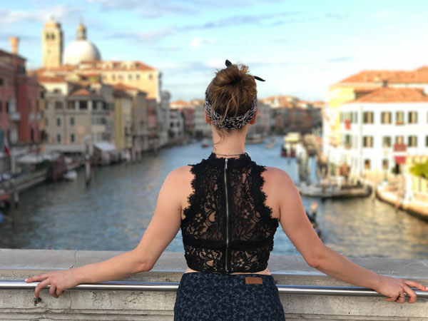 Student overlooking canals in Venice, Italy.