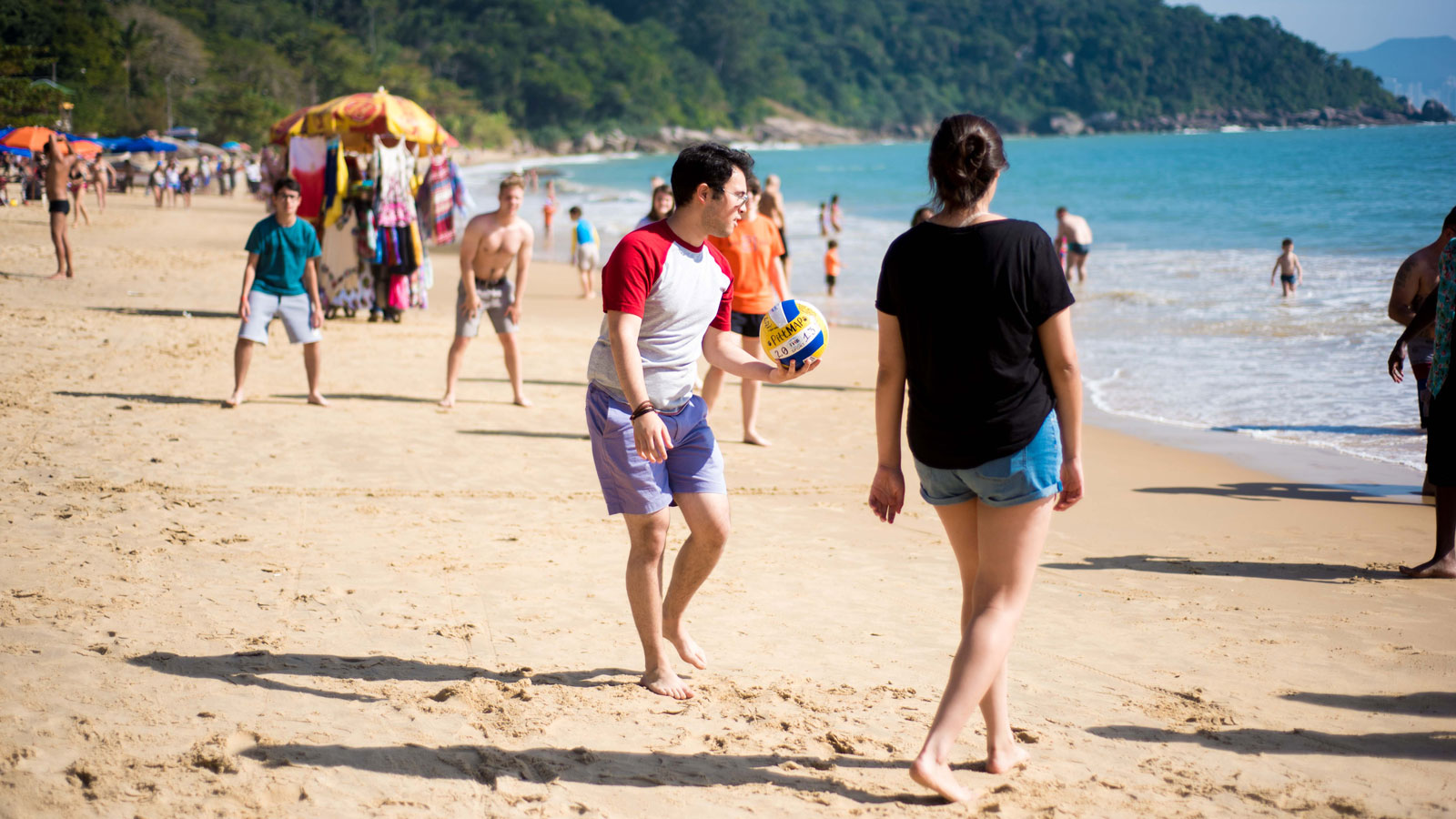 ISA students playing volleyball on a beach in Florianopolis, Brazil
