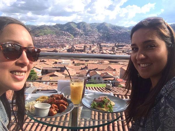 Two girls dining at the Limbus Restobar in Cusco, Peru.