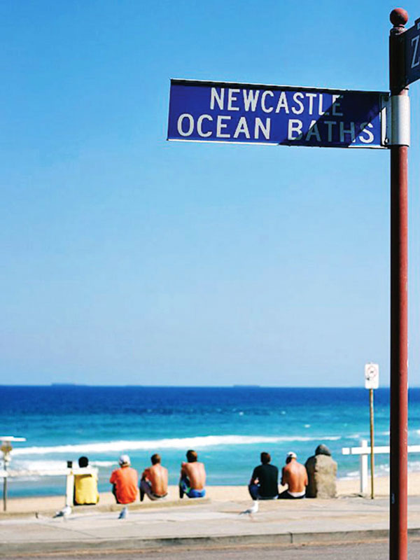Beach signpost in Newcastle, Australia