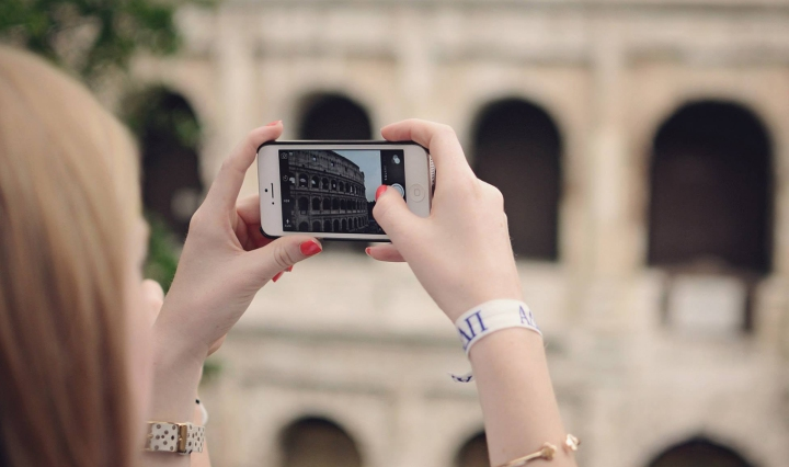 Girl taking photo at the Colosseum in Rome